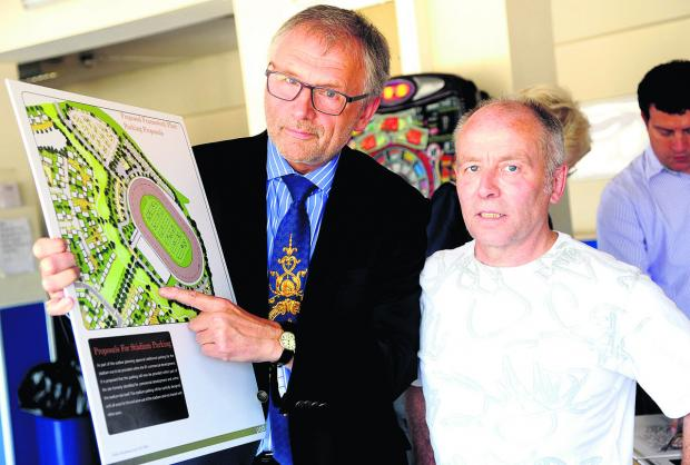 This Is Wiltshire: From left, Clarke Osborne and Roger Wheeler at a public consultation at the Abbey Stadium on plans to build houses at the site