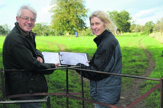 This Is Wiltshire: Bradford on Avon Museum trustee Roy Canham and archaeologist Sophie Hawke at Bearfield Farm, getting ready to uncover its ancient secrets