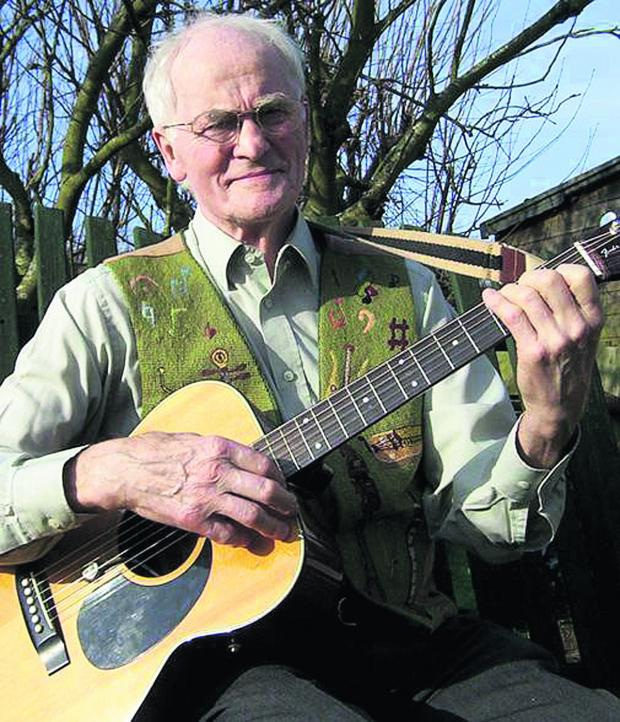 This Is Wiltshire: Mervyn Penny with his guitar, one of many instruments he played