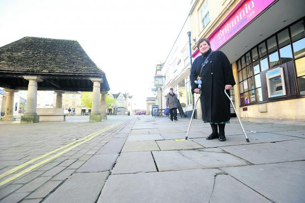 This Is Wiltshire: Coun Mary Fallon conducts a survey of uneven pavements in Chippenham
