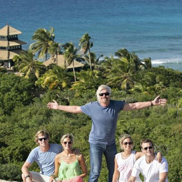 This Is Wiltshire: Sam Branson, Isabella Calthorpe, Richard Branson, Holly Branson and Freddie Andrews pose before their new island home
