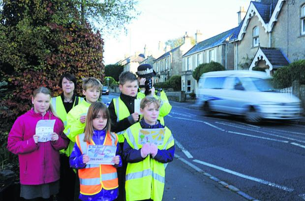 This Is Wiltshire: Box Primary School pupils join Community Speed Watch's Amanda Lewington and PC Mandy Bull last year to target speeding drivers
