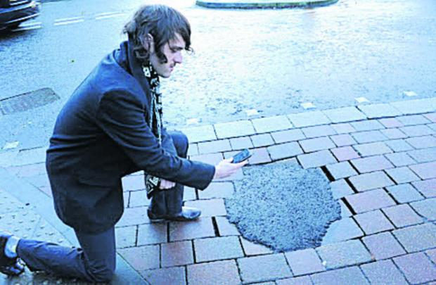 This Is Wiltshire: Reporter Craig Jones with a recently-repaired pothole