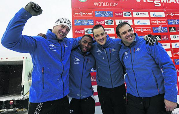This Is Wiltshire: John Jackson, (far right), with his crew of (l-r) Bruce Tasker, Joel Fearon, Stuart Benson celebrate their silver medal in Lake Placid
