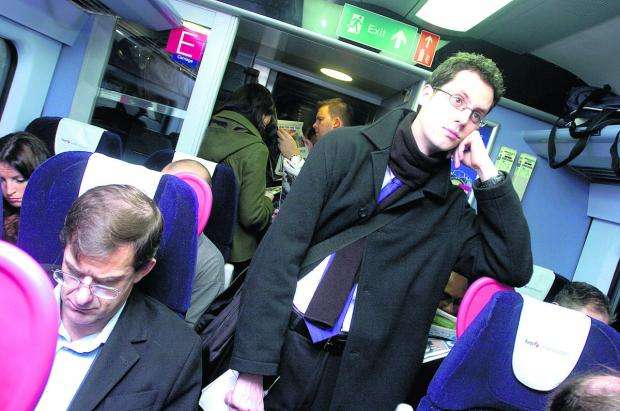 This Is Wiltshire: A crowded train pulls out of Swindon train station