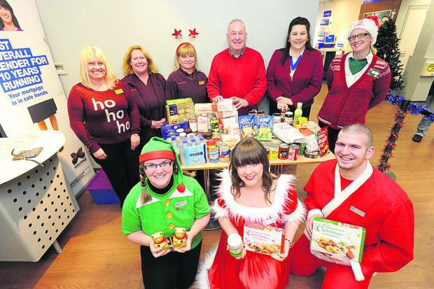 This Is Wiltshire: Alan Beamish, of Devizes Food Bank, and supporters before Christmas