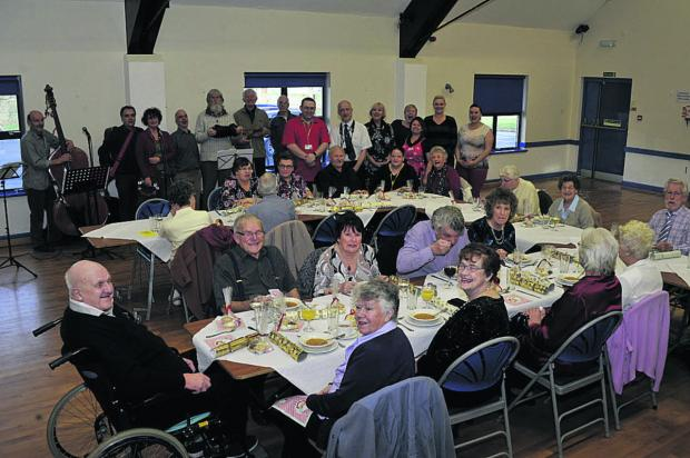 This Is Wiltshire: Weavers Drive residents enjoying a Christmas lunch at the Longfield Community Centre            							      Photo: Glenn Phillips (48000-2)