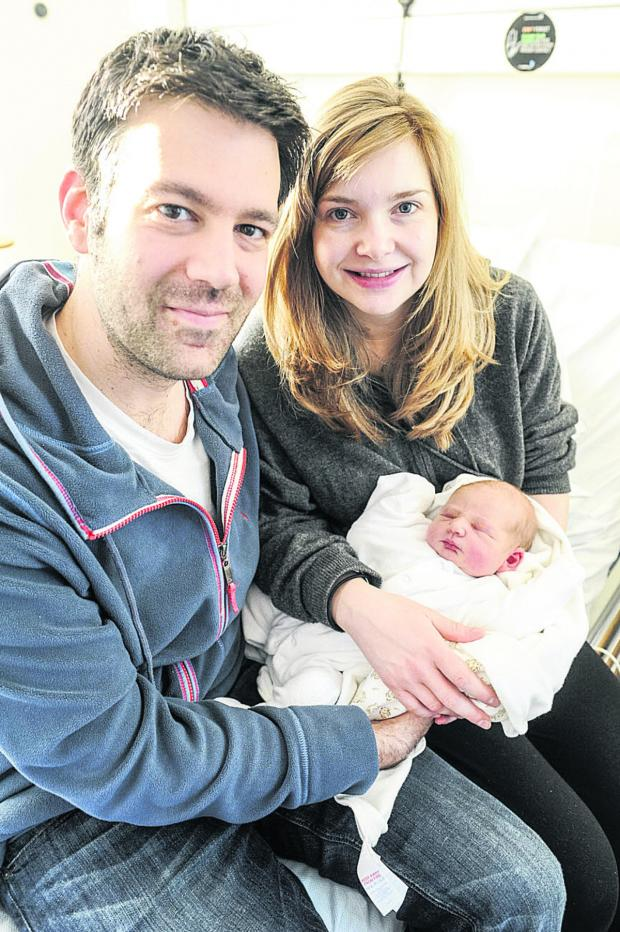 This Is Wiltshire: Dad and mum David and Philippa Heyman with baby girl Alice