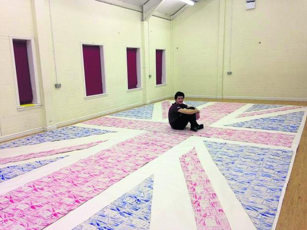 This Is Wiltshire: Xavier Pye with his Union Flag collage made up of images of Sir Winston Churchill