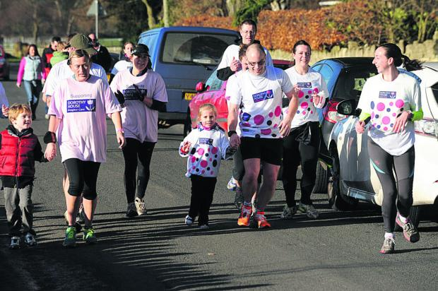 This Is Wiltshire: Phil Halls runs with little Elsie Rhymer-Nott and supporters