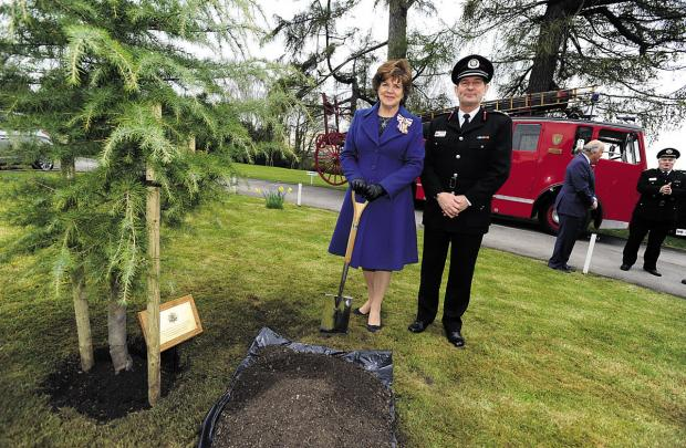This Is Wiltshire: Lord Lieutenant Sarah Troughton  with Chief Fire Officer Simon Routh-Jones planting a tree to commemorate the Queen's jubilee at Wiltshire Fire & Rescue Service headquarters in 2012