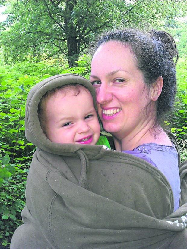 This Is Wiltshire: Becky Martin often takes her two-year-old son Aidan with her when handing out leaflets