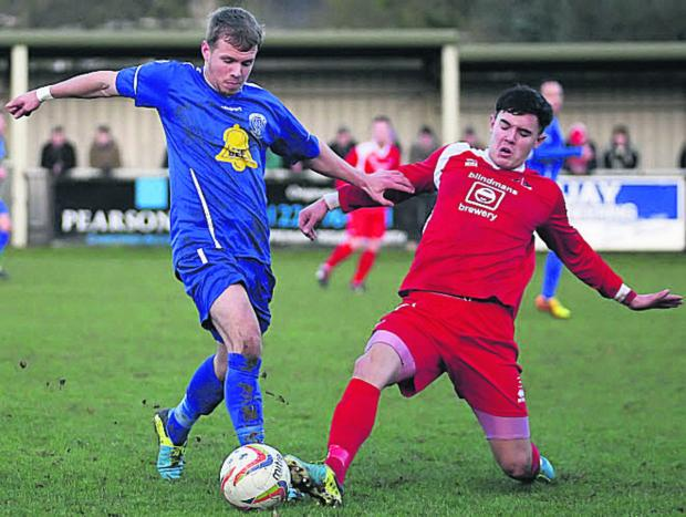 This Is Wiltshire: Frome Town's Rhys Baggridge (right) challenges Chippenham Town's Joe McClennan on Boxing Day