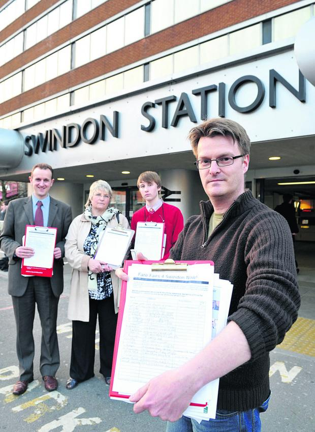 This Is Wiltshire: Chris Watts campaigning against a previous fare rise at Swindon Train Station. Pictured with him gathering a petition are back, left to right, Mark Dempsey, Anne Snelgrove and Kiran Dickinson