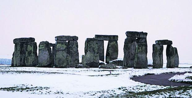 This Is Wiltshire: Stonehenge after snowfall a year ago