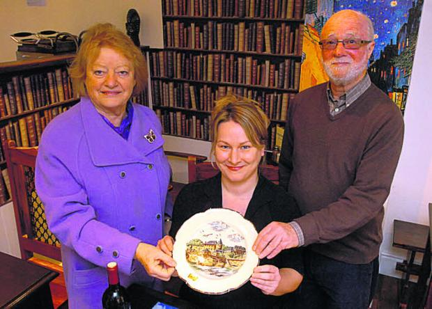 This Is Wiltshire: Rebecca Wood, owner of the Mayenne cafe in Devizes, centre, with, Margaret Taylor and Jasper Selwyn, of Devizes Twinning Association, and the new plate showing Mayenne