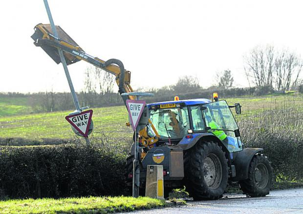 This Is Wiltshire: Police were called after a tractor collided with a lamppost at Seend just after 1.20pm today