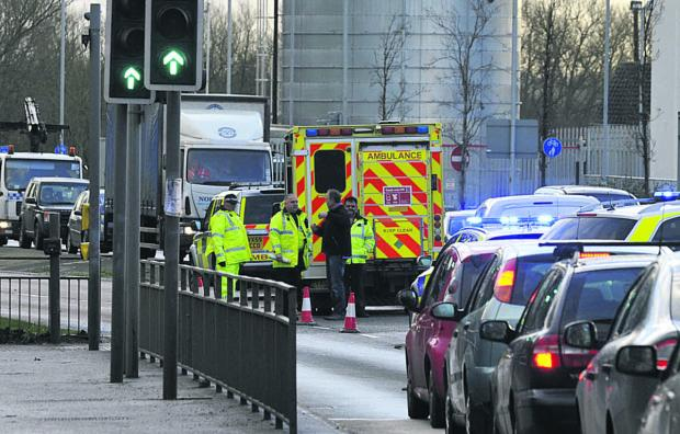 This Is Wiltshire: Police and an ambulance crew at the scene of the accident