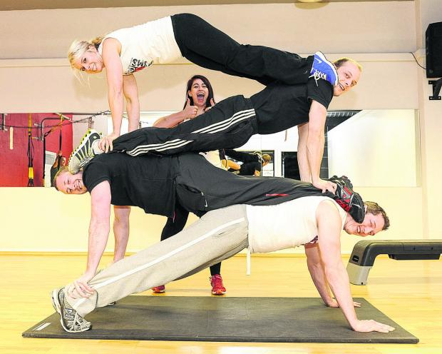 This Is Wiltshire: Instructors at Kiss Gyms, from top to bottom, Heather McNamee, Deon Jarvis, Adam York, Nick Tuckett and, behind, Hannah Golding