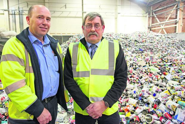 This Is Wiltshire: Waste and recycling supervisor Paul Warren and Richard Hurley, the Cabinet member for housing and public protection at the Waterside Recycling Centre in Cheney Manor