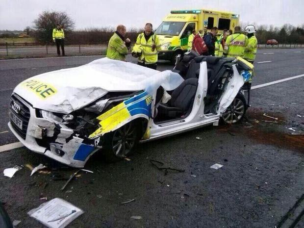 This Is Wiltshire: The wreckage of the police car that crashed on the M4 on Sunday