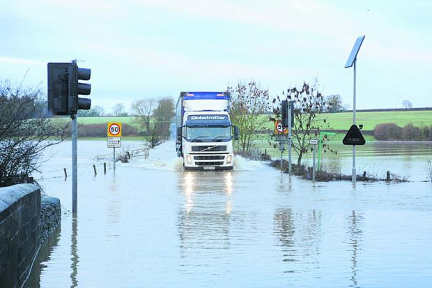 This Is Wiltshire: A lorry negotiates the flood water at Staverton, between Bradford on Avon and Trowbridge
