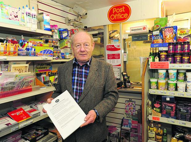 This Is Wiltshire: Westwood Stores owner Ray Parsons at the current post office counter