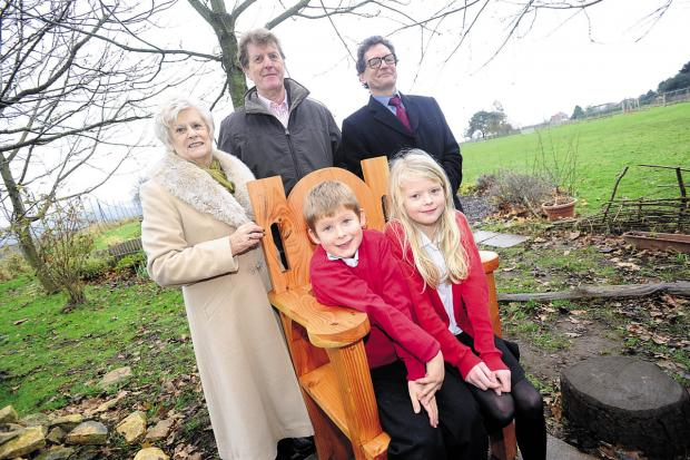 This Is Wiltshire: Pupils Billy and Evie sitting in the chair with, from left, Audrey Forrest and Chippenham Wiltshire Vale Rotary Club members Alan Atkins and Jonathan Shipton