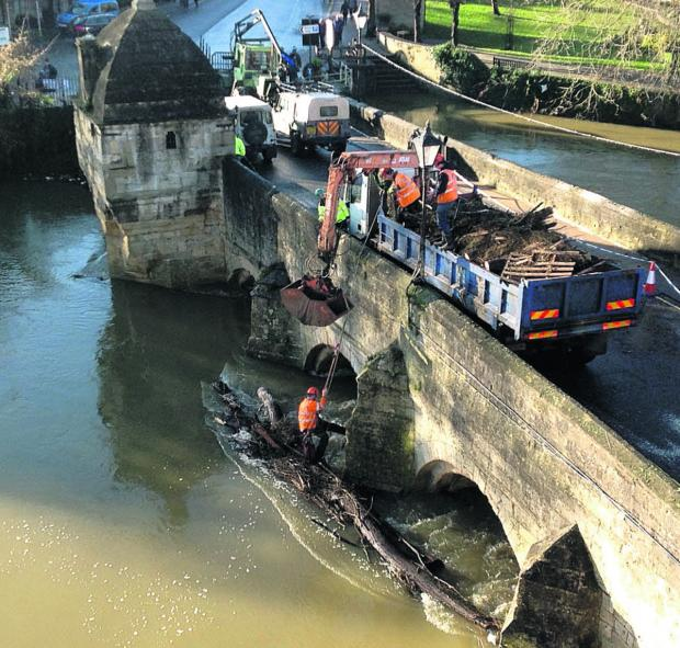 This Is Wiltshire: Measures will be put in place to help prevent destruction on the scale of the Christmas Eve floods, says Bradford on Avon mayor John Potter