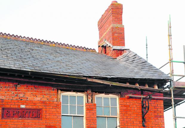 This Is Wiltshire: The former Three Tuns pub, in Wroughton, which is  is being turned into a Morrisons store has suffered roof damage in the high winds