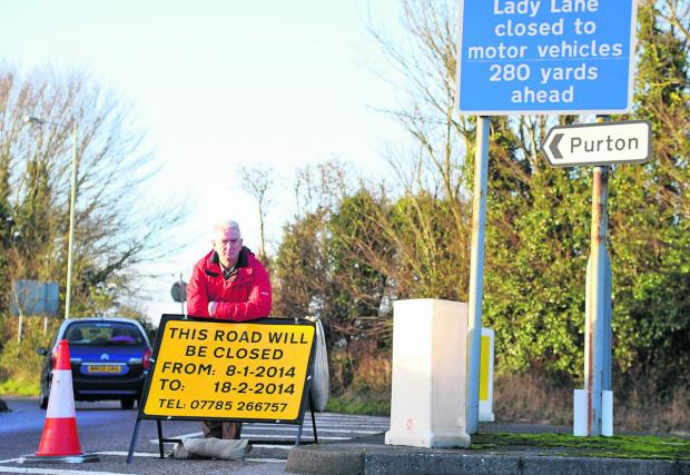This Is Wiltshire: Blunsdon Parish Council chairman Ian Jankinson in Tadpole Lane, which is being closed to allow construction traffic through to build a new school