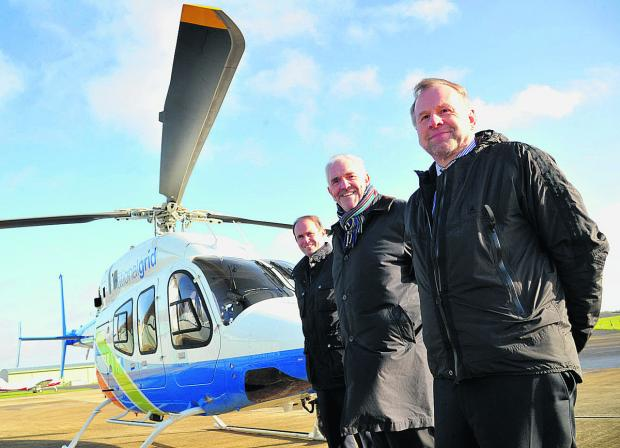 This Is Wiltshire: Bell regional sales manager Rob Pennell, Heli Charter chief executive Ken Wills and Wiltshire Air Ambulance Charitable Trust chairman Chris Lear with the helicopter