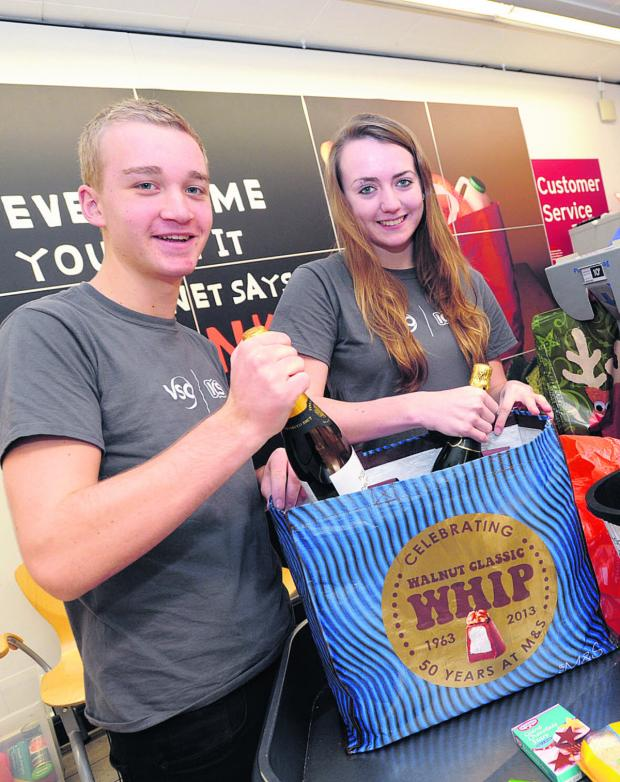 This Is Wiltshire: Charlie Coleman and Sophie Taylor fundraise by bag packing in Sainsbury's