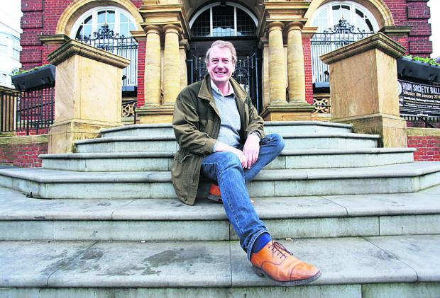 This Is Wiltshire: Stonemason John Lloyd on the steps of Marlborough Town Hall
