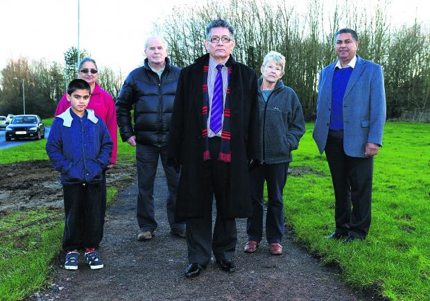 This Is Wiltshire: Residents have campaigned to get a footpath upgraded from Liden to the hospital. Pictured are Randeep Grewal, Jasbinder Grewal, John Macclay, Coun Derique Montaut, Caroll Skiggs and Jas Grewal