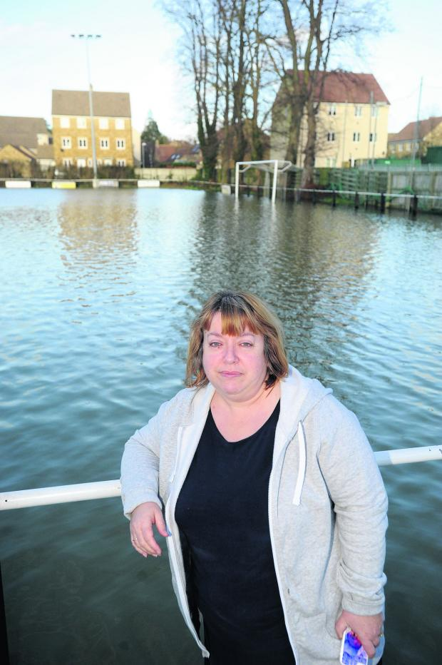 This Is Wiltshire: Malmesbury Victoria secretary Julie Exton at the flooded Flying Monk Ground this week