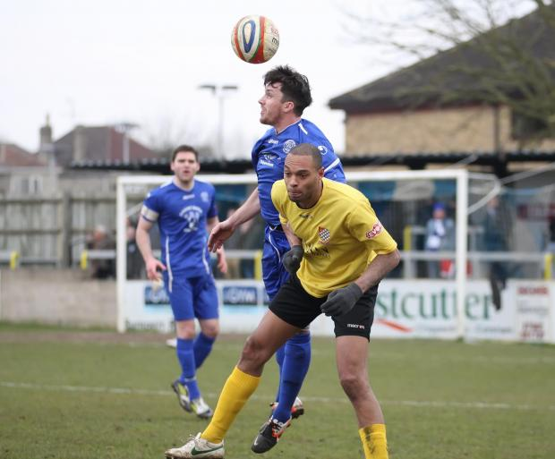This Is Wiltshire: Chippenham Town's Jack Allward (blue) returned to training this week