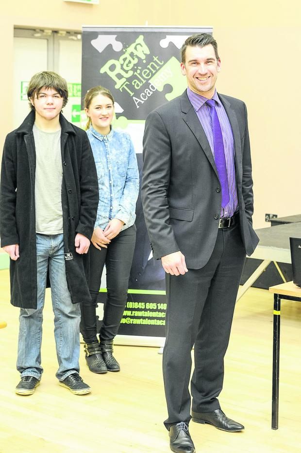 This Is Wiltshire: Lee McQueen, the former winner of The Apprentice, speaking to students at Swindon College. From left, James East, Lee McQueen and  Leah Toomey