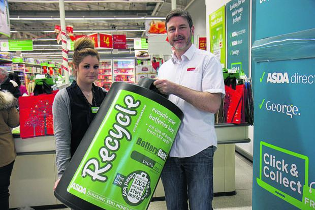 This Is Wiltshire: ASDA's Emma Perrett takes delivery of a battery bin from Mark Lloyd, of Protomax
