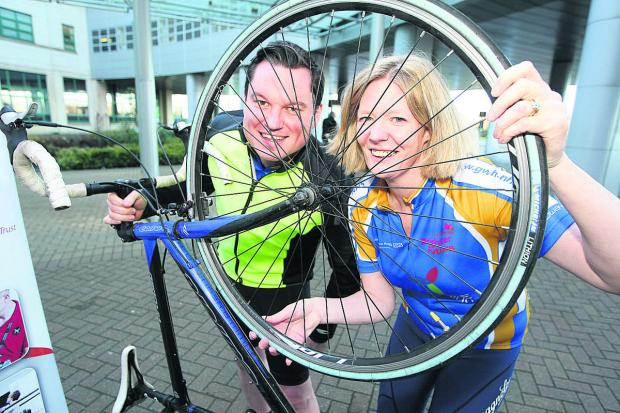 This Is Wiltshire: Great Western Hospital director of strategy Kevin McNamara and director of worrkfoce and education Oonagh Fitzgerald who are taking part in the three cities' cycling challenge to raise money