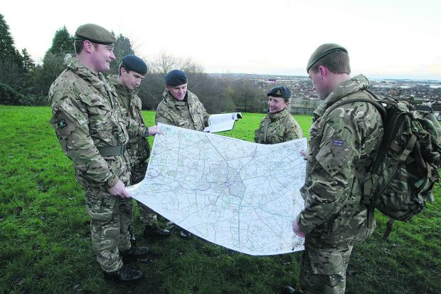 This Is Wiltshire: Defence Academy students from Shrivenham in Lawn woods, during a planning exercise. From left, Jamie Metcalfe-Tarren, Rich Carter, Phil Herbert, Annabel Felton and Jamie Allan