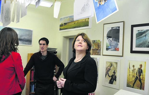 This Is Wiltshire: Culture Secretary Maria Miller admires the work of resident artist Chris Dunn at the Pound Arts Centre