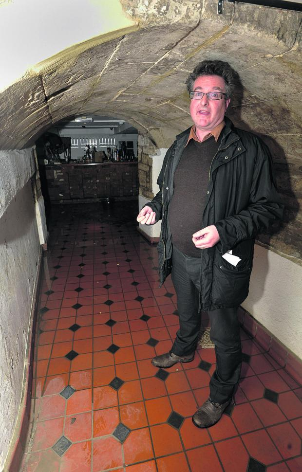 This Is Wiltshire: Swan owner James Sullivan-Tailyour in his flooded cellar bar