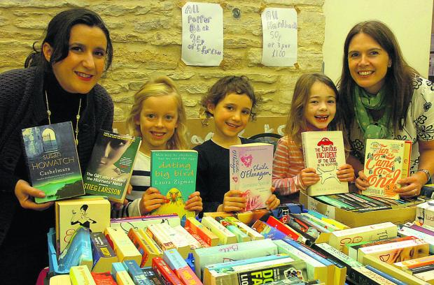 This Is Wiltshire: Leisa Watson, Lottie, Libby, Martha and Julia Pugh run a book stall at the first Sherston market