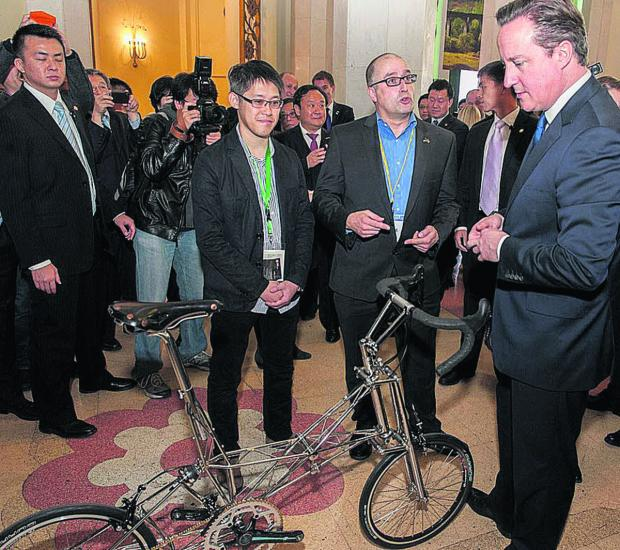This Is Wiltshire: Steven Harvey of Moulton Bicycle Company with Prime Minister David Cameron during the trade trip to China