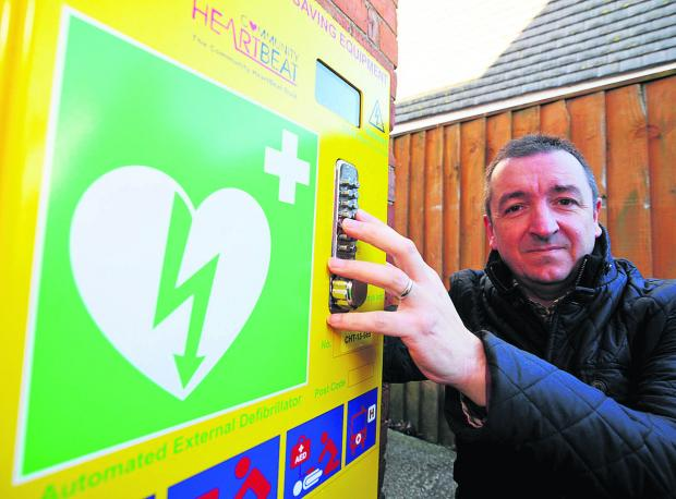 This Is Wiltshire: Wanborough Parish Council chairman Gary Sumner with the last of three defibrilators which can be used by the public in emergencies
