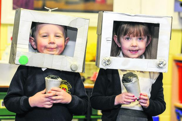 This Is Wiltshire: Pupils at Liden Primary as news reporters