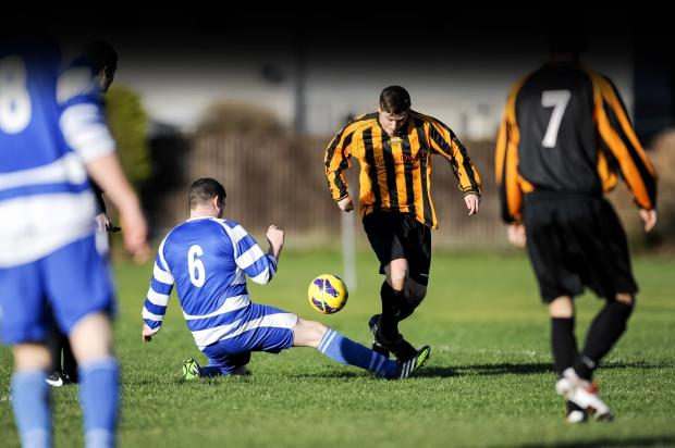 This Is Wiltshire: Action from the Wiltshire League game between Wroughton and Blunsdon on Saturday