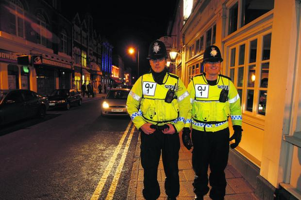 This Is Wiltshire: Police on patrol in Wood Street, Swindon ,on a Saturday night
