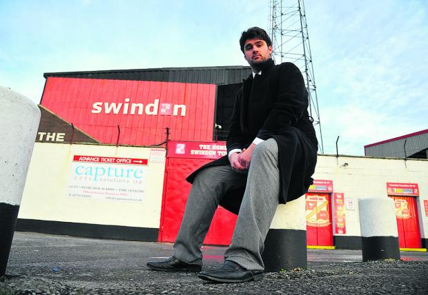 This Is Wiltshire: Sam Morshead waits outside the ground for Swindon Town fans before their trip to Stevenage